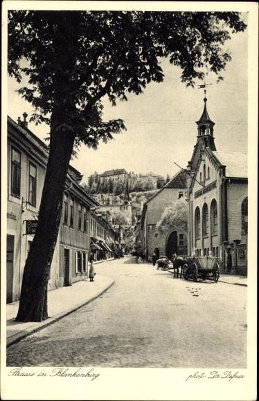 Blankenburg am Harz, Straßenpartie mit Pferdekarren und Kirche
