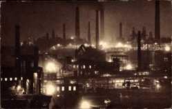 Postcard Völklingen im Saarland, Blick auf die Eisenwerke bei Nacht, Schornsteine