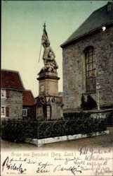 Postcard Burscheid Berg. Land, Eingezäuntes Denkmal an der Kirche
