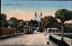 Postcard Szombathely Ungarn, Kalvaria, Straßenpartie mit Blick auf Kirche, Straßenbahn
