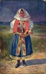 Künstler Ak Janovsky, J. K., Do kostela, Frau in Slowakischer Tracht