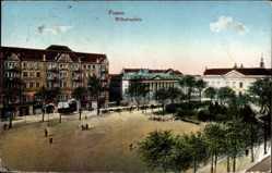 Ak Poznań Posen, Blick auf den Wilhelmplatz, Häuser, Passanten