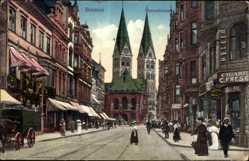 Postcard Hansestadt Bremen, Die Obernstraße mit Geschäften und Kirche