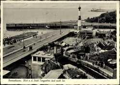 Postcard Bremerhaven, Blick a. d. Städt. Tiergrotten, Luftbild, Straßenpartie