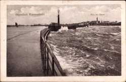 Postcard Rostock Warnemünde, Ansicht der Mole bei Sturm