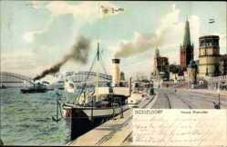 Postcard Düsseldorf am Rhein, Neues Rheinufer mit Brücke und Stadt