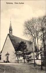 Postcard Nyköping Schweden, Östra Kyrkan, Straßenpartie an der Kirche
