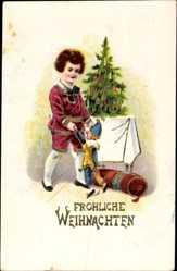 Postcard Frohe Weihnachten, Kind mit Marionette am Tannenbaum