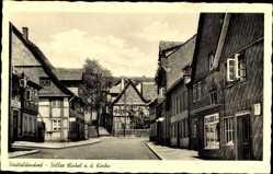 Postcard Stadtoldendorf in Niedersachsen, Stiller Winkel an der Kirche