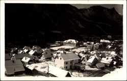 Foto Ak Assling Slowenien, Blick auf den Ort im Winter, Berge, Schnee