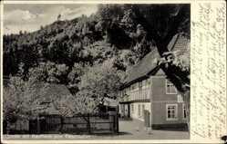 Postcard Questenberg Südharz, Gasthaus zum Felsenkeller, Eingang, Zaun, Fachwerk