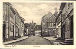 Postcard Kelbra im Kreis Mansfeld Südharz, Blick in die Markststraße,Geschäft Schnelle
