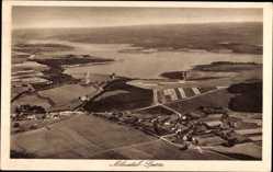Postcard Möhnesee, Fliegeraufnahme vom Ort mit Möhnetalsperre
