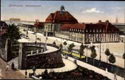 Postcard Dortmund im Ruhrgebiet, Blick auf den Hauptahnhof, Straßenseite, Straßenbahn