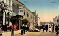Postcard Ruttka Slowakei, Straßenpartie, Fö utcza, Fässer, Hotel Vasuti Szailoda