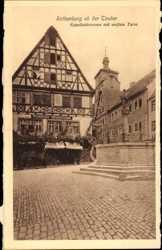 Kapellenbrunnen mit weißem Turm